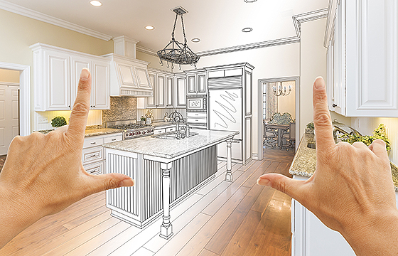 hands framing a layout for a new kitchen design